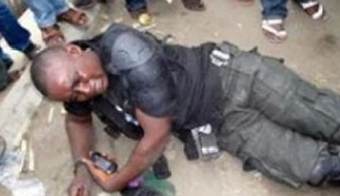 police man down 300x225 2 - Drama In Apapa As A Nigerian Soldier Was Beaten To A Pulp
