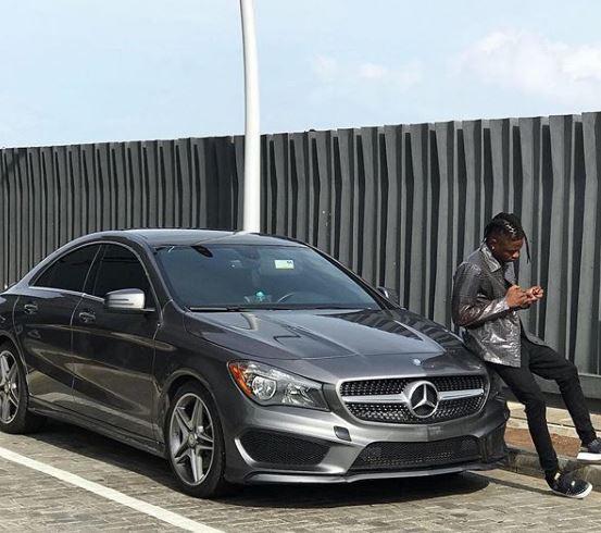 [Photos]: Lil Kesh flaunts new Benz