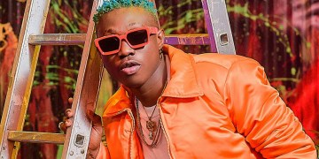 Zlatan Ibile Calls God In Edo Language While Getting A Tatoo On His Stomach (Video)