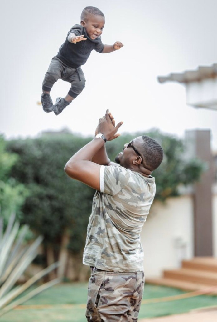 John Dumelo and son