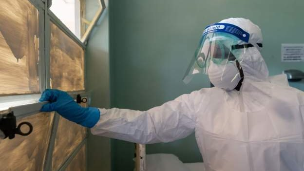 Scientist check for coronavirus