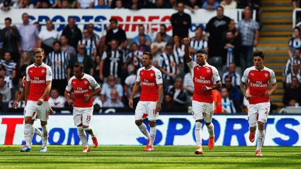 Alex Oxlade-Chamberlain Celebrates With Team-Mates after Watching Fabricio Coloccinin Deflect His Shot for Arsenal Goal at Newcastle. Image: Getty.