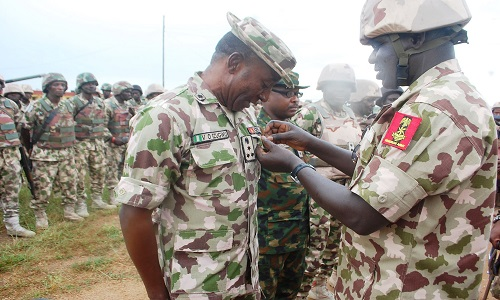 PIC. 9. THE CHIEF OF ARMY STAFF, LT.-GEN. TUKUR BURUTAI (R), DECORATING WITH A MEDAL, BRIG.-GEN. VICTOR EZUGWU, THE COMMANDER, OF THE 28 TASK FORCE BRIGADE FIGHTING INSURGENTS, DURING THE CHIEF OF ARMY STAFF'S VISIT TO MUBI IN ADAMAWA ON WEDNESDAY