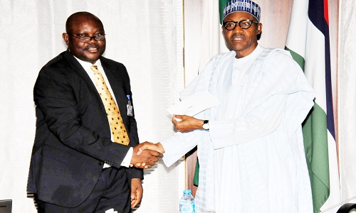PIC. 24. PRESIDENT MUHAMMADU BUHARI (R), RECEIVING HIS NATIONAL IDENTITY CARD FROM THE DIRECTOR-GENERAL, NATIONAL IDENTITY MANAGEMENT COMMISSION (NIMC), MR CHRIS ONYEMENAM, AT THE PRESIDENTIAL VILLA IN ABUJA ON WEDNESDAY (14/10/15). 7258/14/10/2015/ICE/CH/BJO/NAN