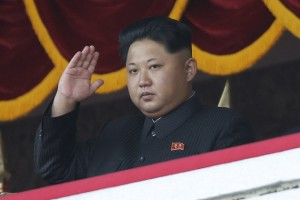 North Korean leader Kim Jong Un gestures as he watches a military parade in Pyongyang, North Korea, Saturday, Oct. 10, 2015. North Korea is holding one of its biggest celebrations for the 70th anniversary of its ruling party's creation. (AP Photo/Maye-E Wong)