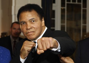 US former heavyweight boxing champion Muhammad Ali gives a punch in front of photographers at hotel Belvedere in Davos 28 January 2006. AFP PHOTO ERIC FEFERBERG (Photo credit should read ERIC FEFERBERG/AFP/Getty Images)