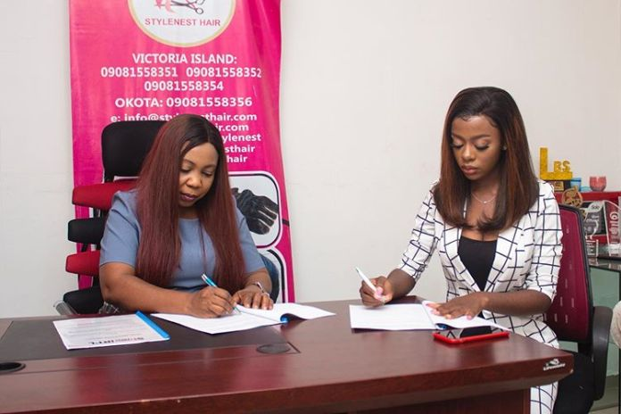 Diane signing the endorsement deal