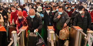 People wearing face masks as a preventive measure against the COVID-19