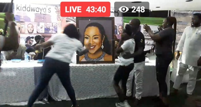 The portrait of Erica being presented to Kiddwaya