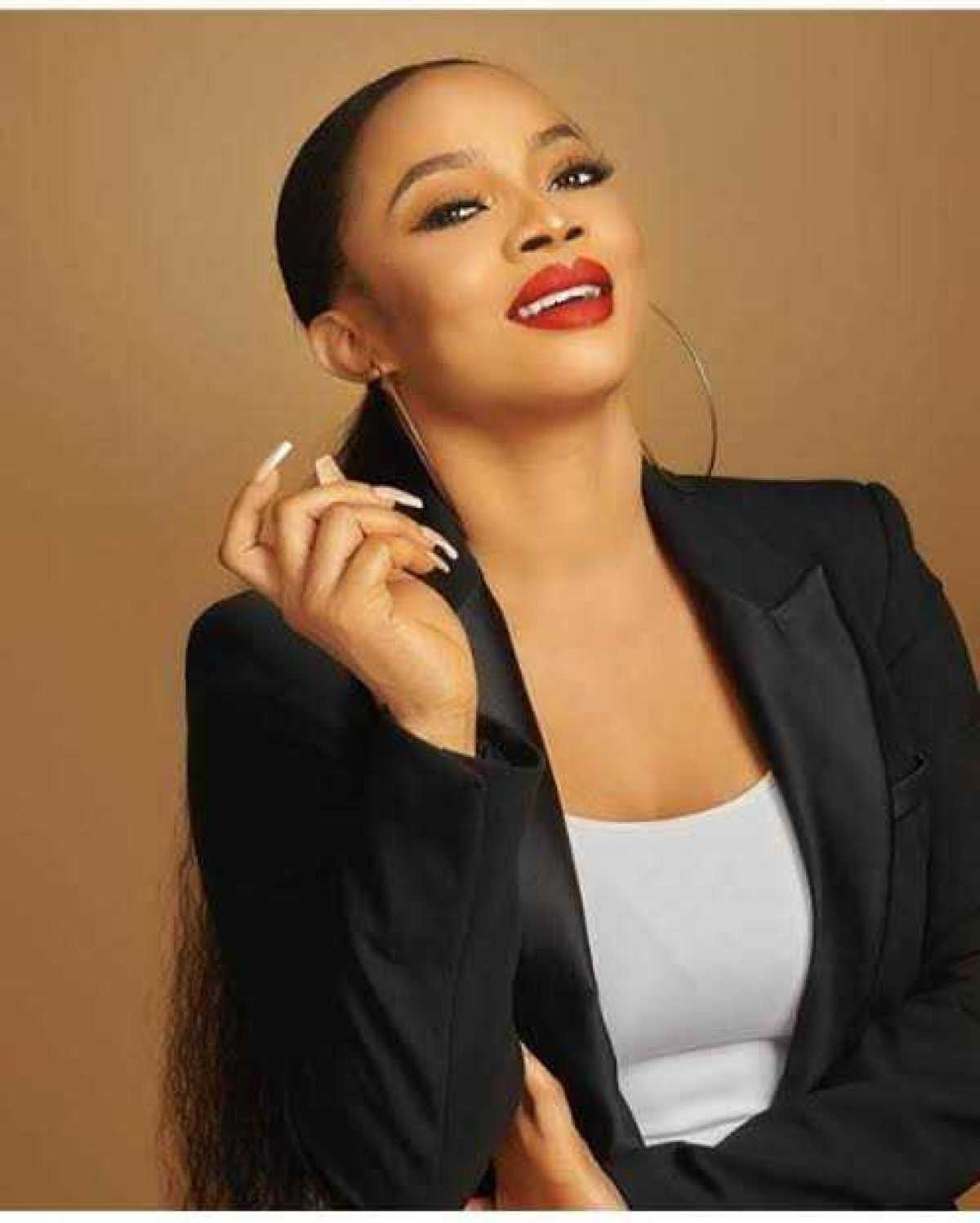 """""""God will punish you"""" – Toke Makinwa slams Twitter user who said she and her friends came to show off their designer outfits at #EndSARS protest"""