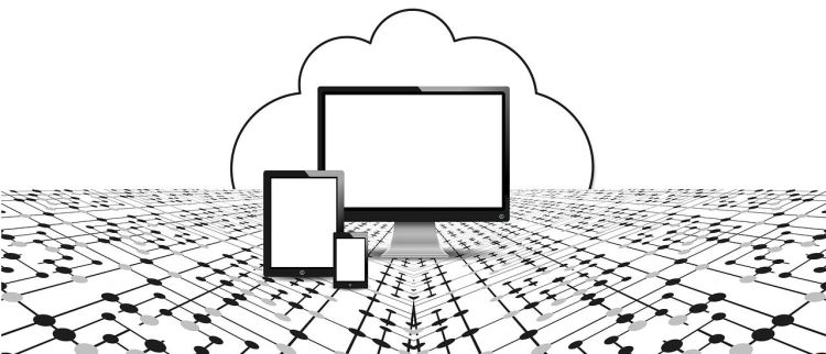 Black and white photo of PC screen, tablet and smart phone in front of cloud; used to illustrate the meaning of cloud backup.