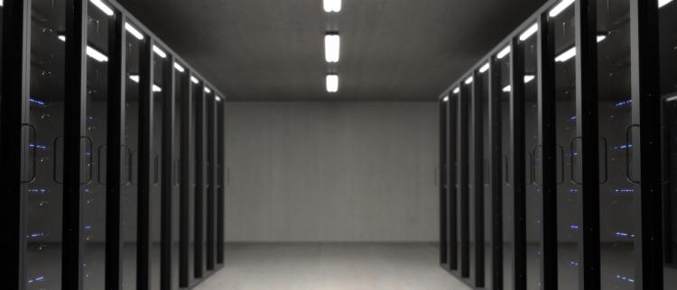 Color photo of a black server room, used to illustrate the storage of Big Data.