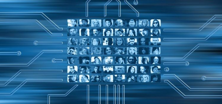 Color photo of several human faces on screens - used to illustrate the meaning of companies and how they collect data.