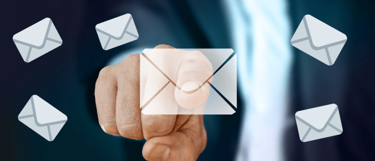 Color photo of a mans' finger pointing at the email icon; used to present one of the 2021 Cybersecurity predictions.