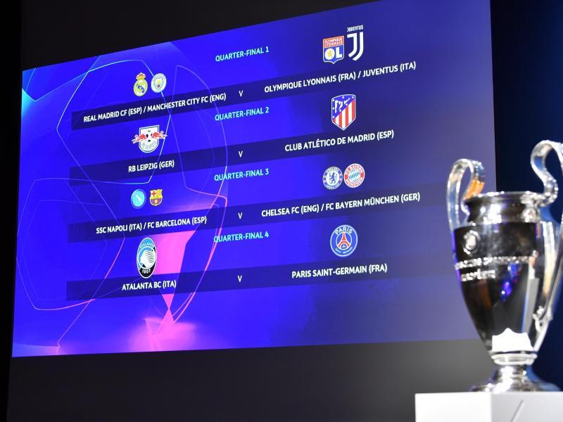 Ein Blick auf die Anzeige mit den Begegnungen für das Viertelfinale der Champions League. Foto: Harold Cunningham/UEFA via Getty Images/dpa