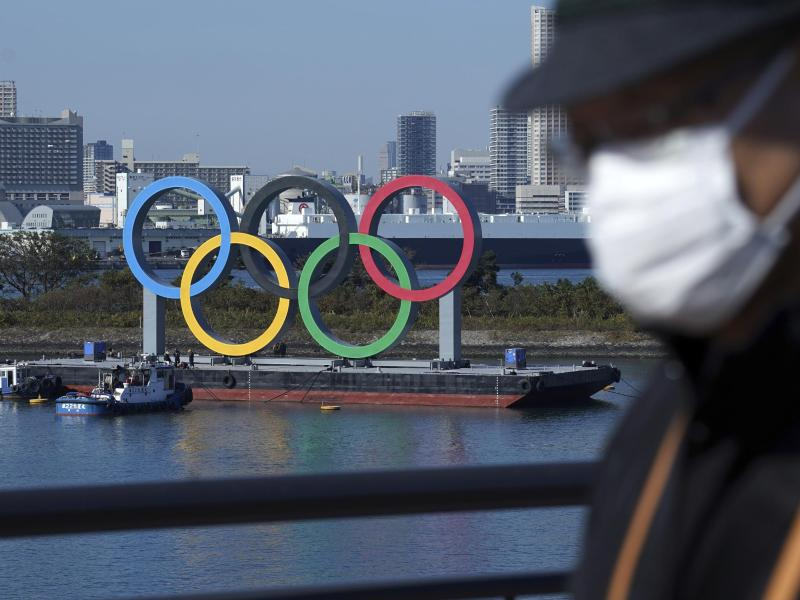 Bei den Olympischen Spielen in Tokio soll es eine generelle Maskenpflicht geben. Foto: Eugene Hoshiko/AP/dpa