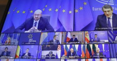 Ein Bildschirm zeigt Charles Michel (l, oben), Präsident des Europäischen Rates, der per Video an einem EU-Sondergipfel teilnimmt. Foto: Olivier Hoslet/Pool EPA/AP/dpa
