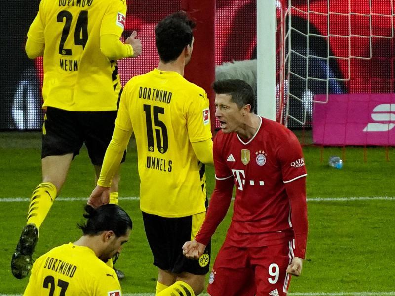 Dreifach-Torschütze Robert Lewandowski jubelt über seinen Treffer zum zwischenzeitlichen 2:2. Foto: Günther Schiffmann/AFP-POOL/dpa