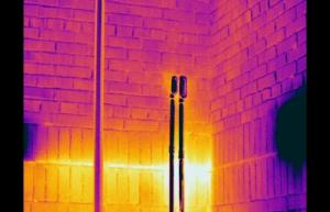 Blocked drains allow water build up behind brick wall - Infrared Imaging Services LLC