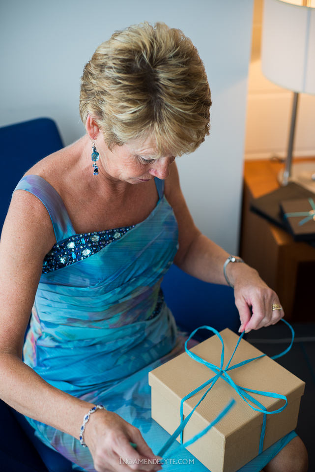 brides mother unpacking a present
