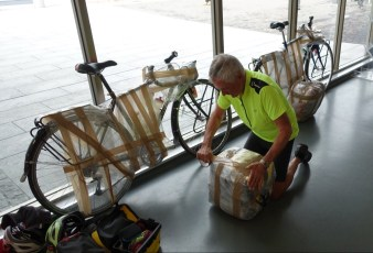 Bikes wrapped and ready. Wrapping panniers together.