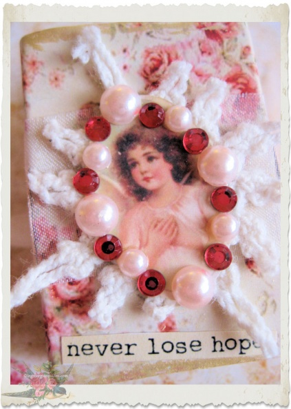 Never lose hope details of handmade matchbox with vintage girl by Ingeborg van Zuiden