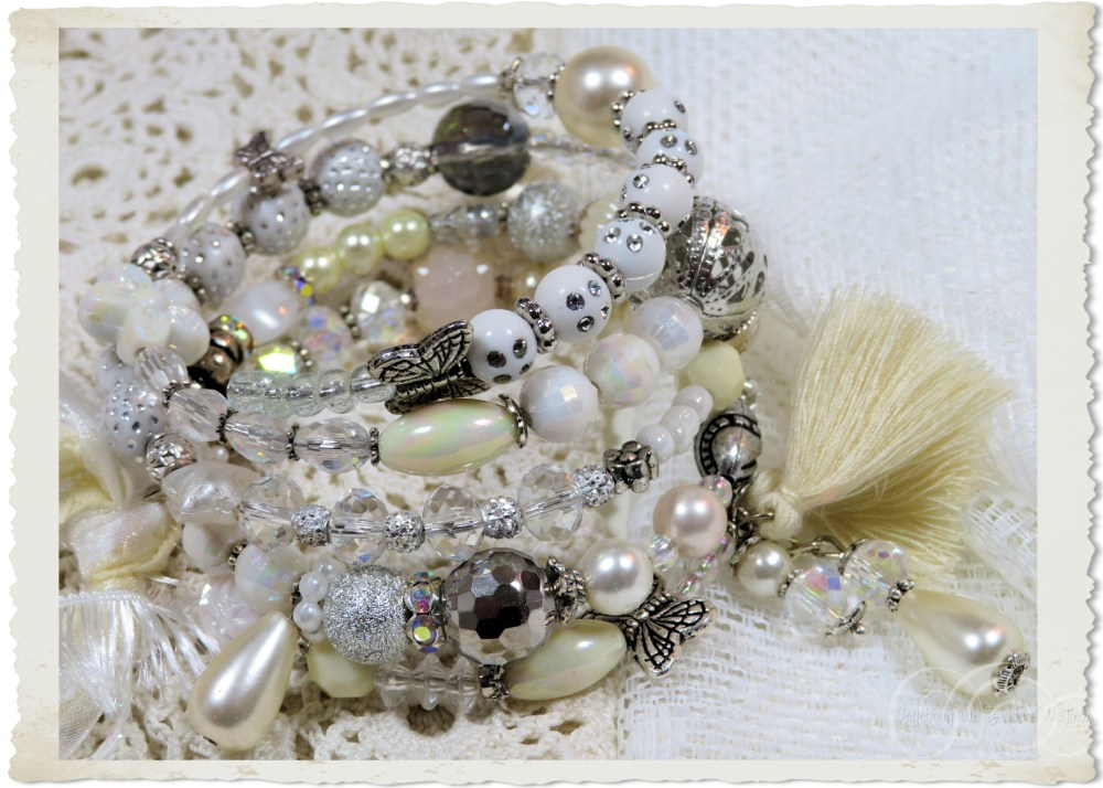 Memory wire bracelet with white silver beads