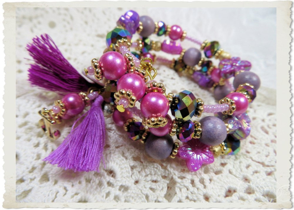 Lots of gold spacers in between purple and magenta beads