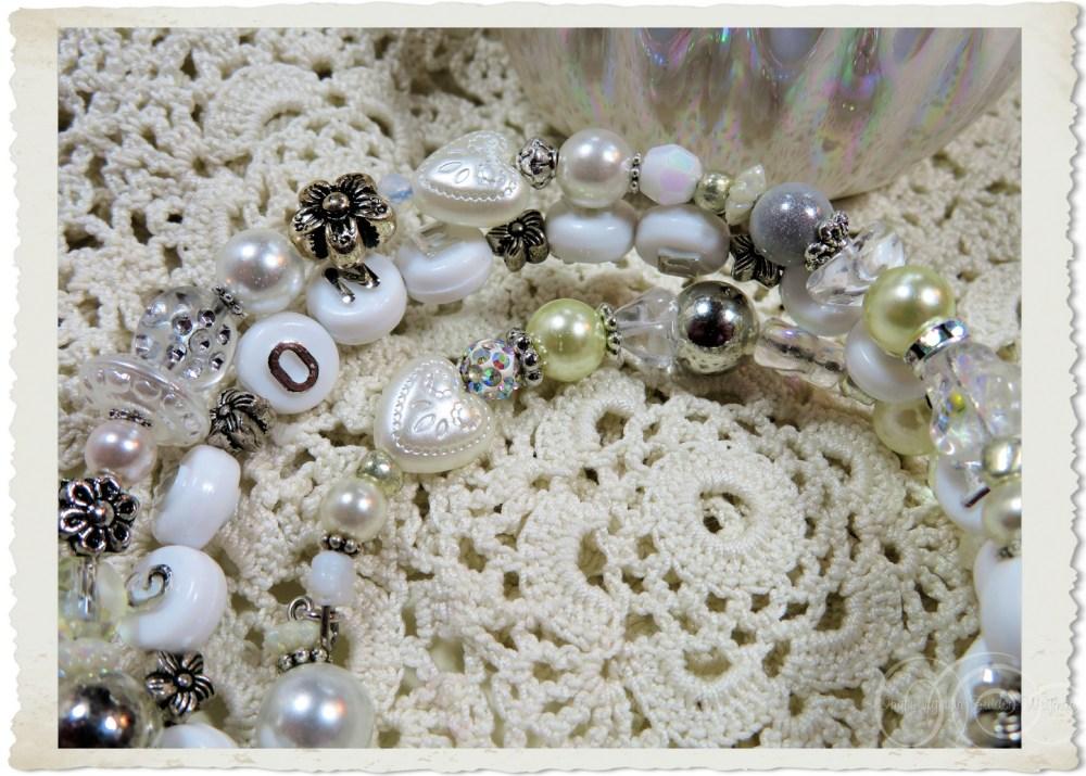 Details of white prayer bracelet with wordart