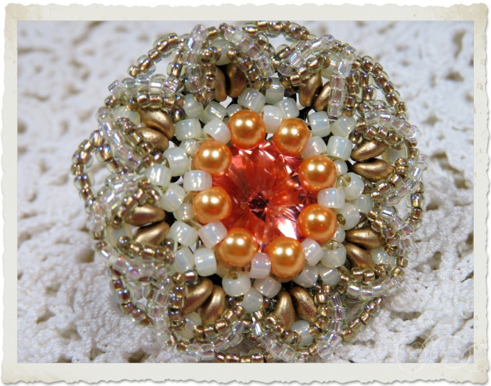 Swarovski ring with peach pearls and Superdo beads
