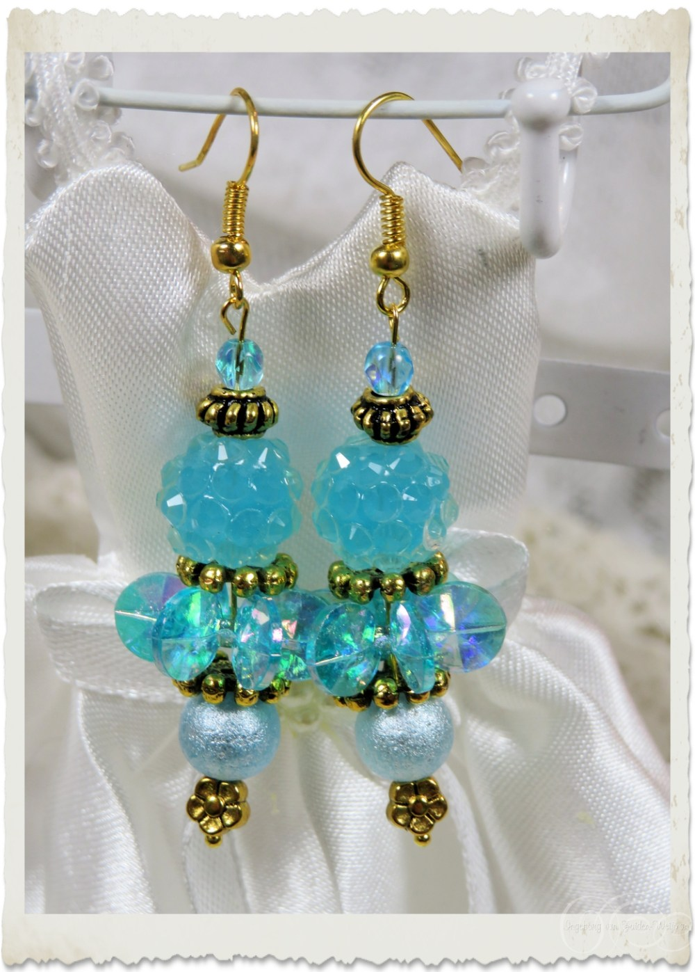 Turquoise blue angel earrings