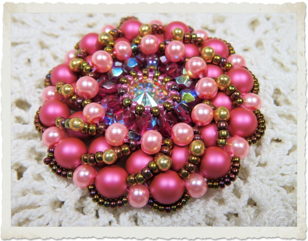 Pink bling beaded brooch by Ingeborg van Zuiden