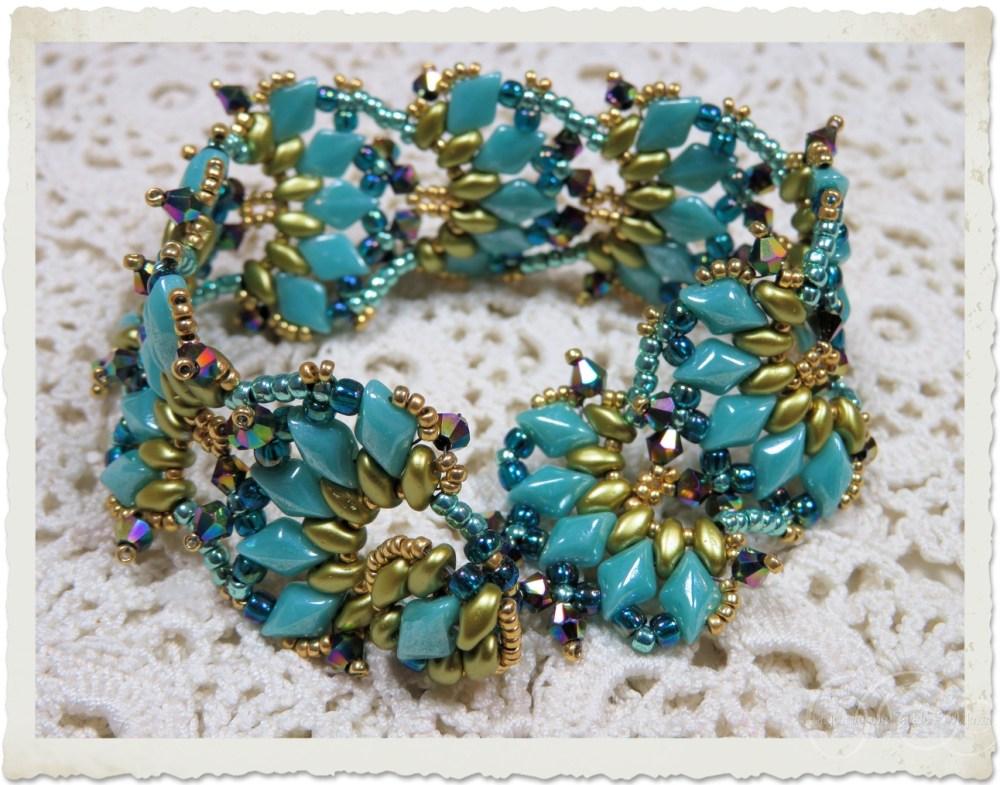 Peacock gold bracelet by Ingeborg van Zuiden
