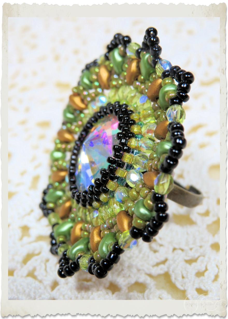 details of handmade black green bling ring