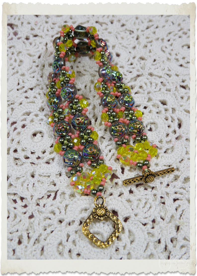 Handmade bead weaving bracelet with yellow ab crystal czech beads and 2-hole cabochon beads