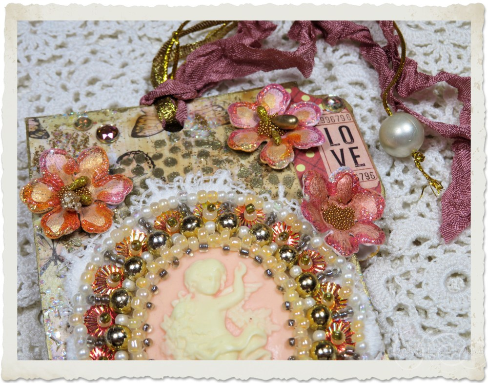 Details of embroidery and paper flowers