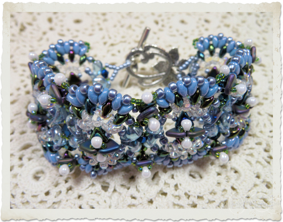 Handmade blue beadweaving bracelet with Khéops and Triangle beads as well as  superduo beads by Ingeborg van Zuiden