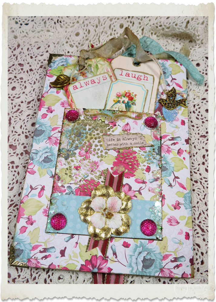 Backside of handmade card with wordart tags and flowers