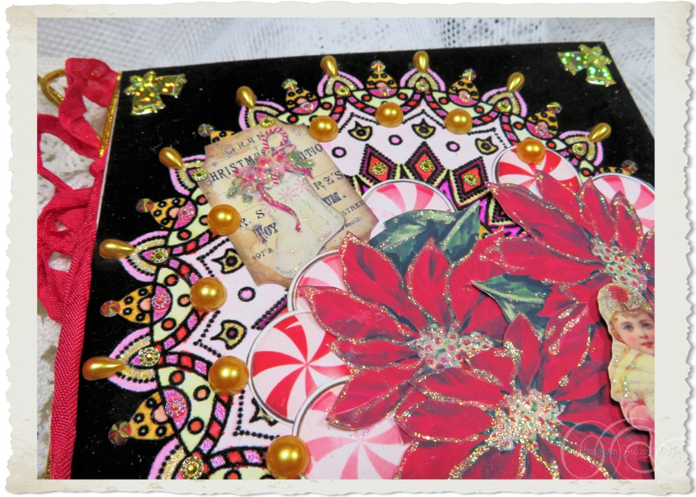 Details of handmade Christmas card with poinsettia flowers and mandala drawing