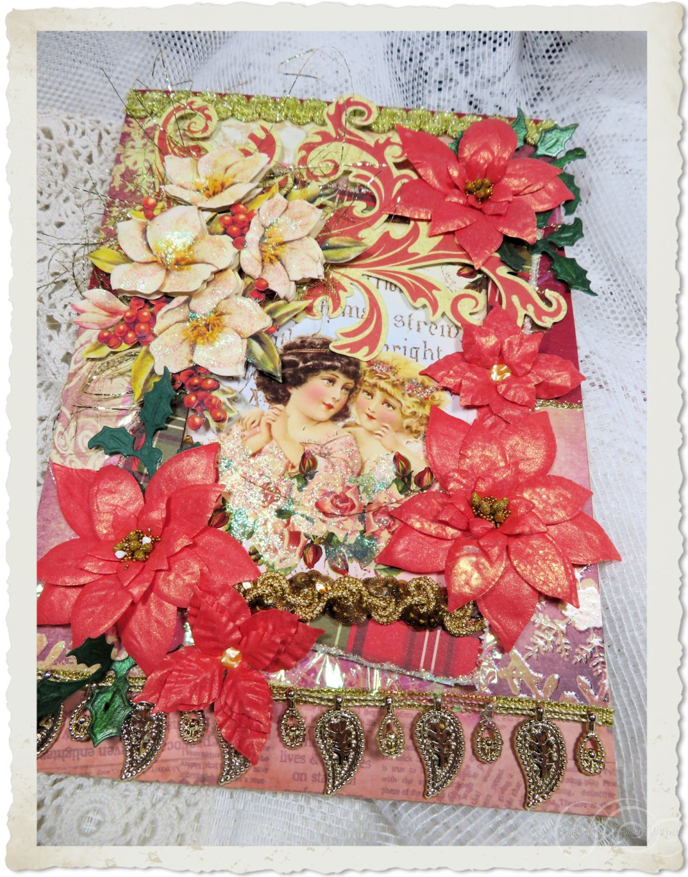 Handmade vintage style Christmas card with red poinsettia flowers