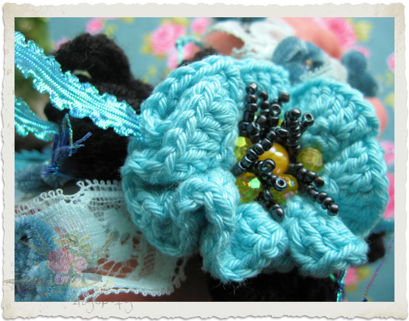 Details of handmade crochet bracelet with turquoise flower and lace