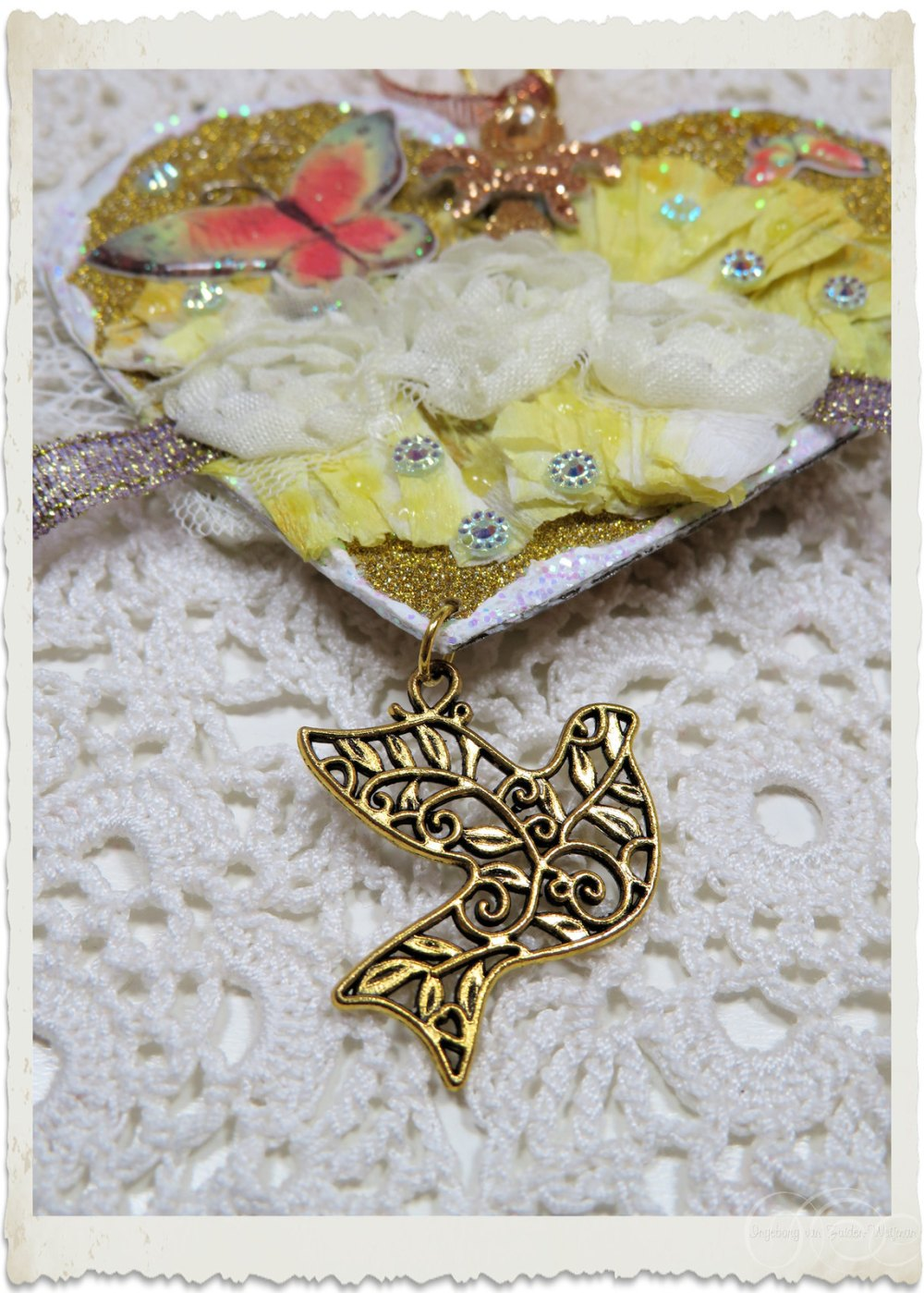 Pretty gold dove charm on handmade art project