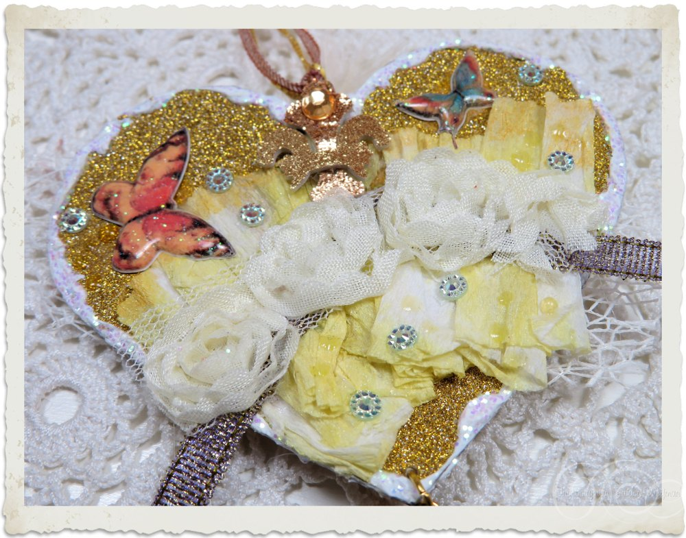 Details of the back of handmade mixed media heart with ruffles and lace roses by Ingeborg van Zuiden