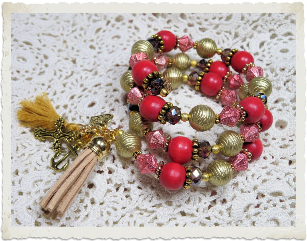Red Gold memory wire prayer bracelet with religious charms and tassels by Ingeborg van Zuiden