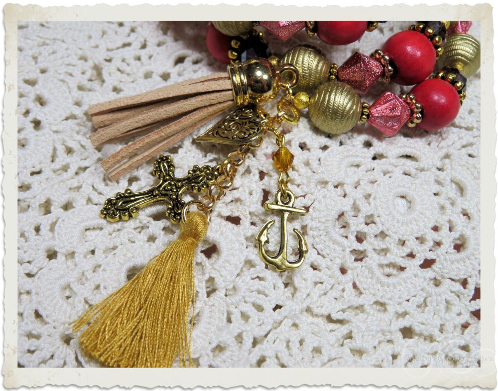 Gold tassels and religious charms on a handmade memory wire bracelet