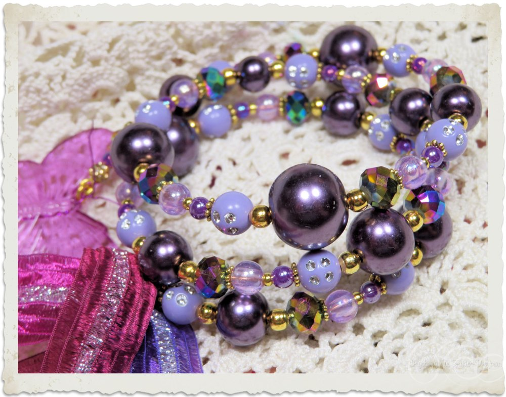 Purple lilac beaded memory wire bracelet with butterfly charm