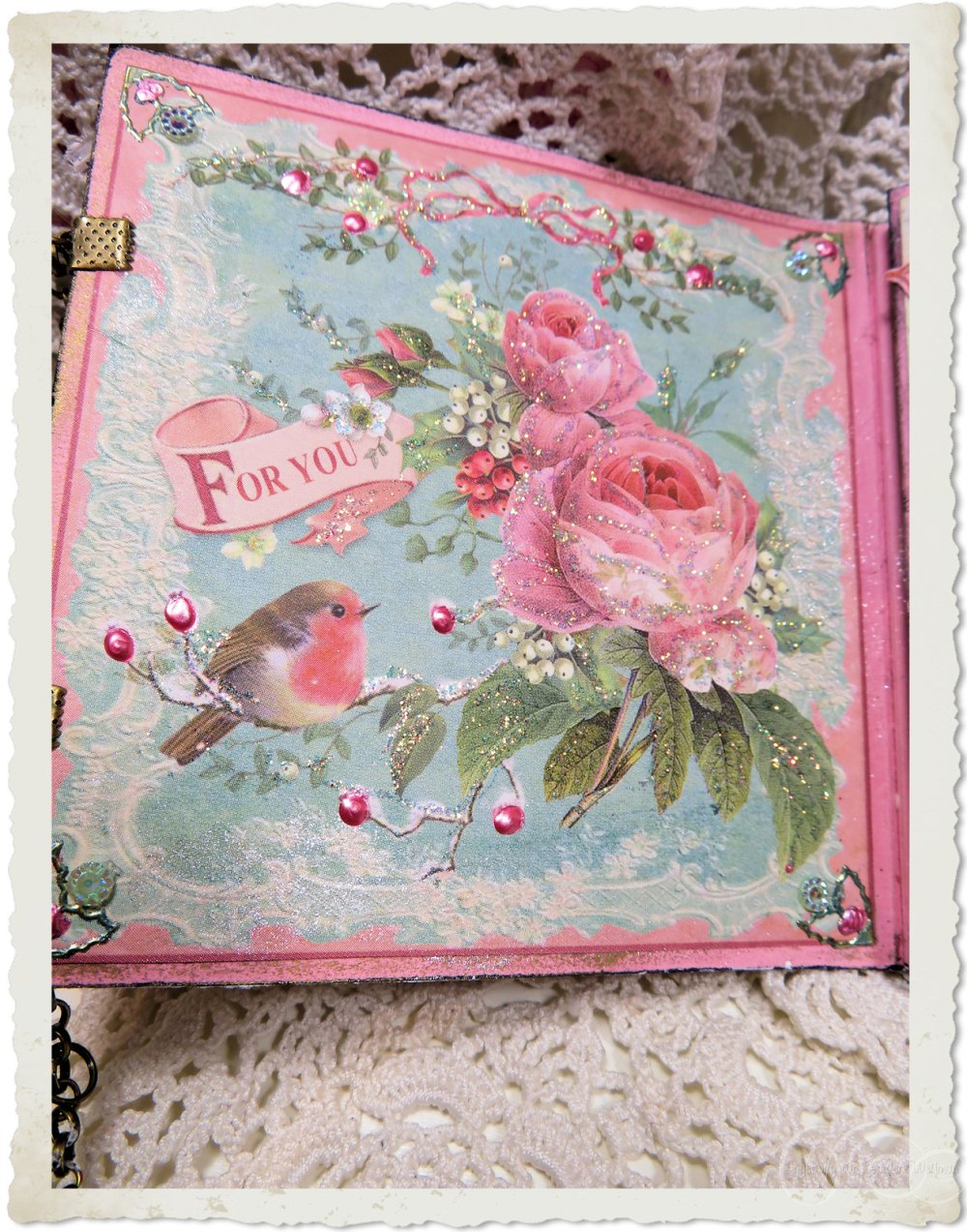 First inside page with red robin and pastel pink roses in Christmas style
