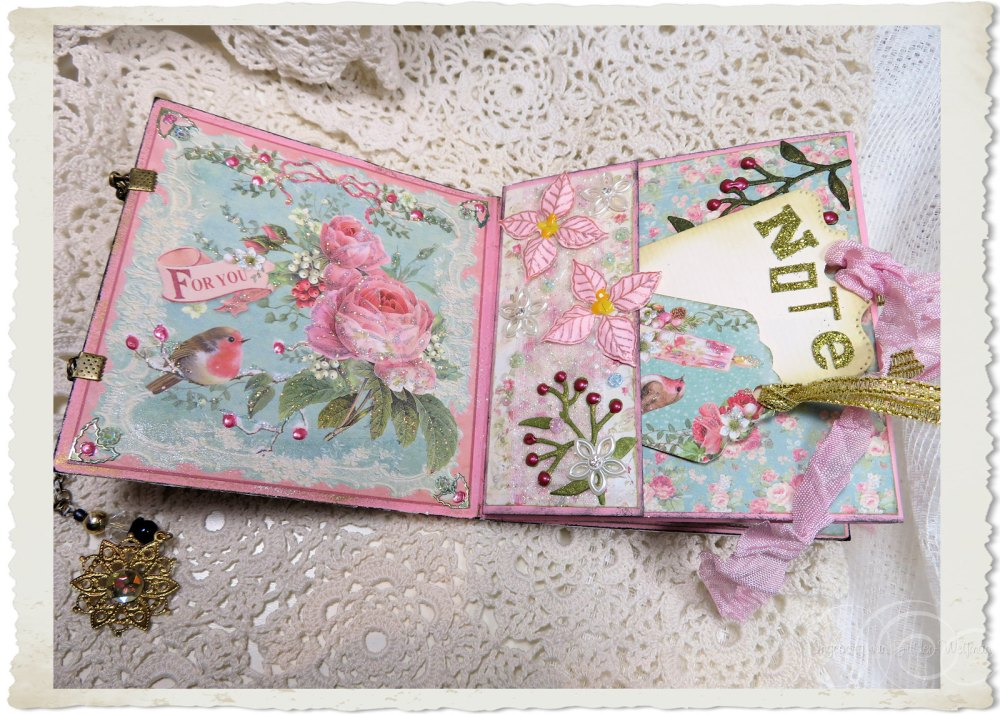First two pages of Christmas booklet with pastel flowers and pocket with labels