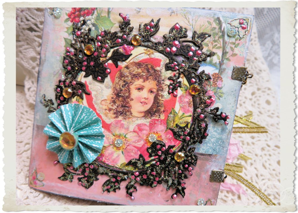 Front of handmade Christmas booklet with angel and roses