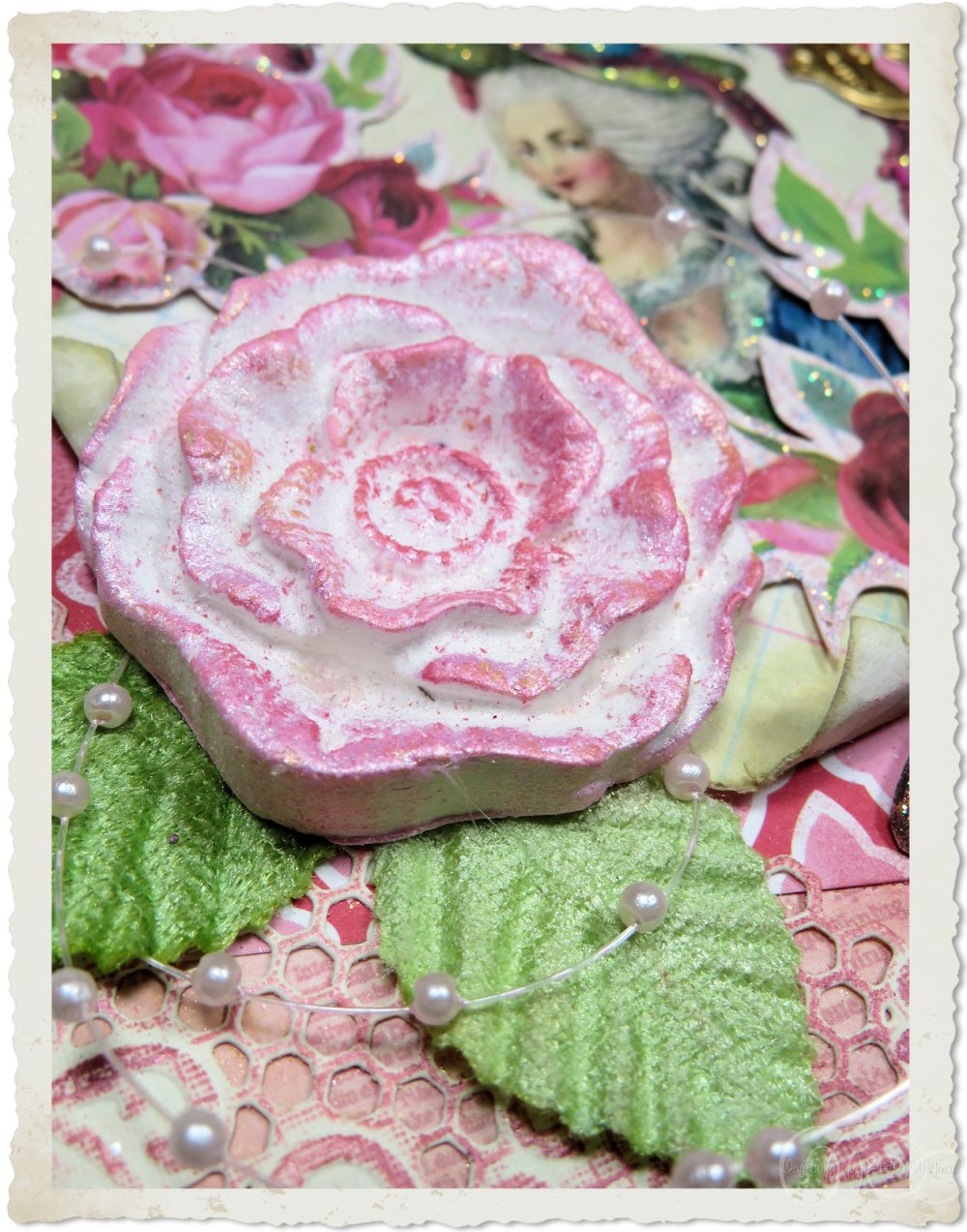 Pink pastel clay rose on a handmade card by Ingeborg van Zuiden